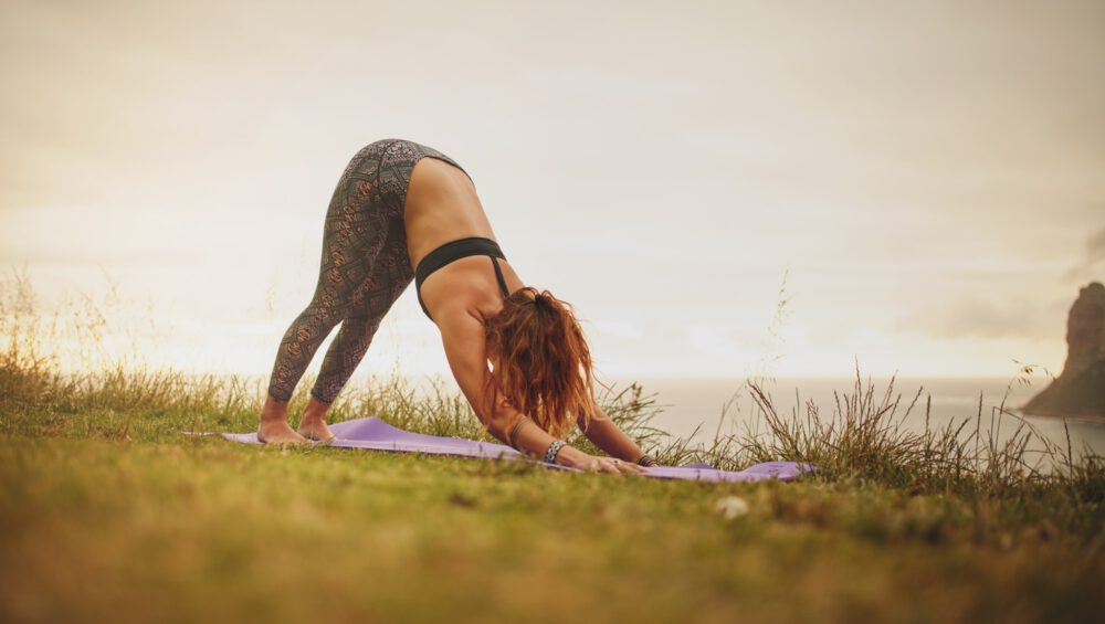 Fitness woman doing yoga outdoor